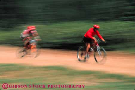 Stock Photo #5865: keywords -  action balance bicycle bicycling bike biker blur bmx compete competing competition competitor contest dirt downhill dynamic fall fast helmet horz human motion mountain move movement moving outdoor outdoors pair peddle power race racers racing recreation ride rider riding risk roll speed sport steer summer transportation wheel wheels