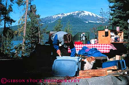 Stock Photo #5900: keywords -  adventure camp camper camping cook cooking diamond equipment explore horz kitchen lake oregon outdoor outdoors outside recreation released sport summer tent travel trip vacation woman