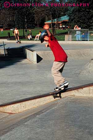 Stock Photo #5905: keywords -  board boy california caution child concrete contour fall glide injury outdoor outdoors outside park rail redding ride risk roll skate skateboard skateboarder skateboarding speed steer terrain vert