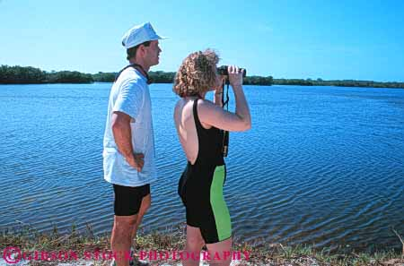 Stock Photo #5975: keywords -  binoculars bird birding birds count counting couple darling fl florida horz husband identify identifying look man nature outdoor outdoors outside refuge see share spot spotting spouse summer team together tracking vision watching wife wildlife