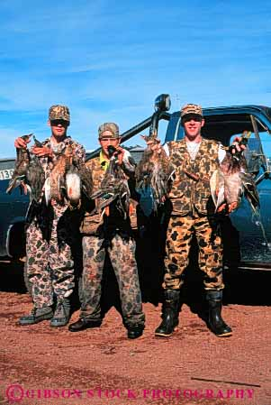 Stock Photo #5982: keywords -  bird birds camouflage duck foul game gun harvest hunt hunter hunters hunting kill outdoor outdoors outside recreation rifle shoot sport sports vert water wildlife