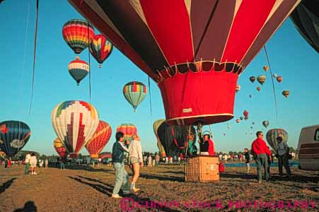 Stock Photo #6009: keywords -  aerial air array balloon ballooning balloons california calm color colorful drift elevate elevated equilibrium float fly flyer flying fresno glide gravity heat horz hot lift lifting lots many multitude off overhead peaceful quiet recreation ride rise rising round solitary solitude sport sports view vlift your