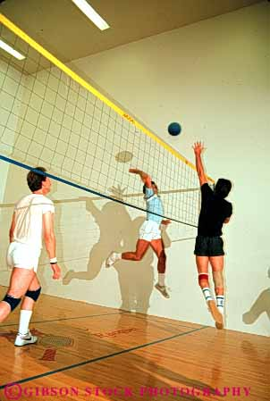 Stock Photo #6209: keywords -  action ball bounce coordinate coordinating coordination court fitness hit indoor jump male man men motion move movement moving net play player players recreation run sport sports team teamwork vert volleyball walleyball woman