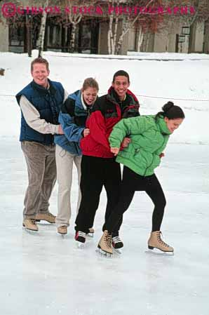 Stock Photo #6230: keywords -  balance cold couple couples ethnic exercise fit fitness four fun glide group hold ice laugh mixed physical physically play recreation released rink skate skater skates skating slide smile sport sports together train vert winter