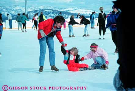 Stock Photo #6241: keywords -  assist balance cold exercise fall fit fitness fun girls glide help helps horz ice learn mother parent physical physically play practice recreation rink single skate skater skates skating slide sport sports teach winter