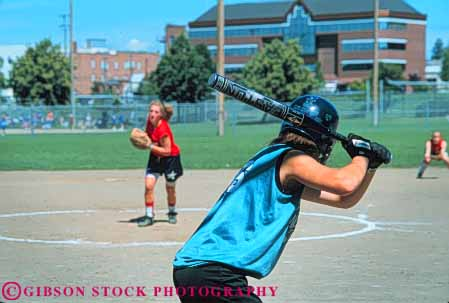 Stock Photo #6269: keywords -  action base baseball bases bat batter batting dynamic fast game girl girls home horz move movement moving pitch pitcher pitches pitching plate play player recreation run runner running runs softball sport sports summer team teen teenage teenager teenagers teens woman youth