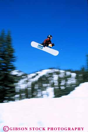 Stock Photo #6298: keywords -  airborn aloft board boarder boarding boy compete competing competition competitor contest danger downhill fall fly flying freestyle helmet injury jump leap recreation risk snow snowboard snowboarder snowboarding soar sport sports teen teenage teenager teenagers teens thrill vert winter youth