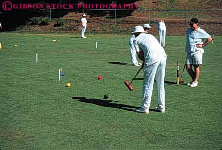 Stock Photo #6310: keywords -  aim ball contest court croquet field game grass green hit hoop horz lawn mallet men outdoor outdoors outside pair play practice precise precision recreation roll skill sport summer tap team two uniform white