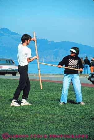 Stock Photo #6331: keywords -  akido art class combat contact defense educate education group learn man martial men outdoor outdoors outside practice recreation skill sport stick student summer vert woman women