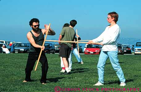 Stock Photo #6333: keywords -  akido art class combat contact defense educate education group horz learn man martial men outdoor outdoors outside practice recreation skill sport stick student summer woman women