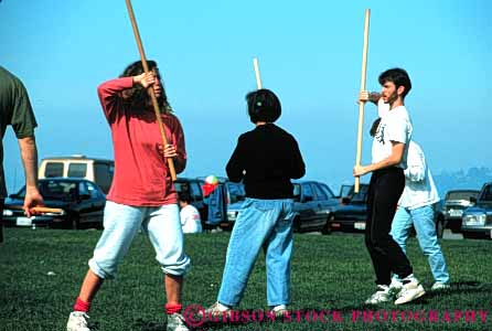 Stock Photo #6334: keywords -  akido art class combat contact defense educate education group horz learn man martial men outdoor outdoors outside practice recreation skill sport stick student summer woman women