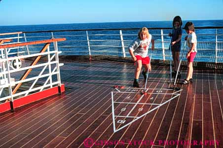 Stock Photo #6354: keywords -  board child children contest cruise deck friction friend friends fun game geometric geometry girl girls group horz line lines pattern play practice push recreation released ship shuffle shuffleboard skill slide sport summer team teams travel trip vacation