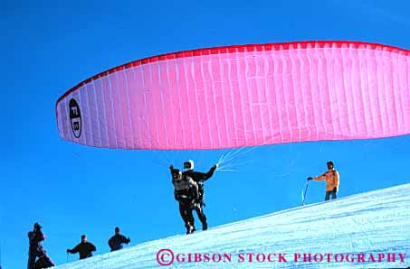 Stock Photo #6363: keywords -  air colorful crash danger dangerous dive drift flight float fly flyer flying glide gravity horz idaho injure injury lift off parachute paraglide paraglider paragliders paragliding pink recreation resistance risk risky sky sport steer sun suspend suspended valley winter