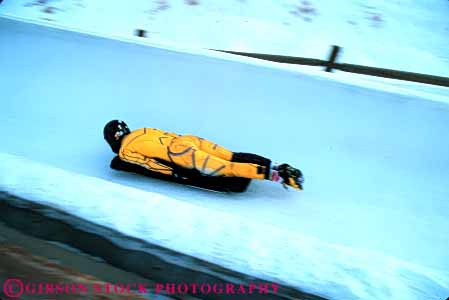 Stock Photo #6368: keywords -  action aerodynamic aerodynamics alone chill chilly chute cold course danger dangerous downhill fast glide glider gliding gravity horz ice icy injury luge motion park race racer racing risk slide slider sliding slip slippery solo speed sport sports suit track utah winter yellow
