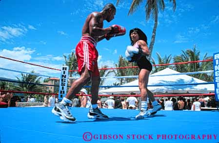 Stock Photo #6373: keywords -  african american beach boxer boxing combat contest couple ethnic female fight fist fl florida game gender glove hit horz learn male man match miami minority mixed outdoor outdoors outside pair play practice punch race racial ring sparing sport student summer teach teachers two warm woman