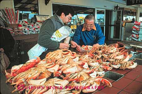 asian man selling market crabs fishermans wharf san