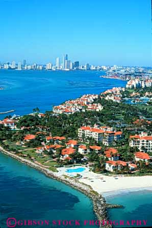Stock Photo #7510: keywords -  aerial aerials america american apartment architecture building buildings business center cities city cityscape cityscapes coast coastal condo development downtown fisher florida island marine miami modern new ocean office resort seashore shore shoreline skyline skylines urban urbanization usa vacation vert