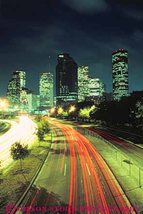 Stock Photo #7559: keywords -  america american architecture blur building buildings business center cities city cityscape cityscapes dark downtown dusk evening houston light lighting lights modern motion move movement moving new night office skyline skylines streak texas traffic urban usa vert west