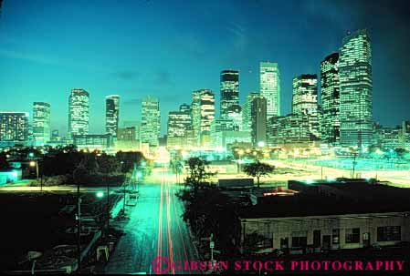 Stock Photo #7560: keywords -  america american architecture building buildings business center cities city cityscape cityscapes dark downtown dusk evening horz houston light lights modern new night office skyline skylines texas urban usa west