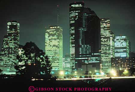 Stock Photo #7561: keywords -  america american architecture building buildings business center cities city cityscape cityscapes dark downtown dusk evening horz houston light lighting lights modern new night office offices skyline skylines texas urban usa west window windows