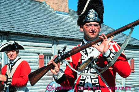 Stock Photo #3391: keywords -  antique colonial costume dress era flintlock fort historic history horz living michigan michilimackinac model red reenactment released rifle soldier