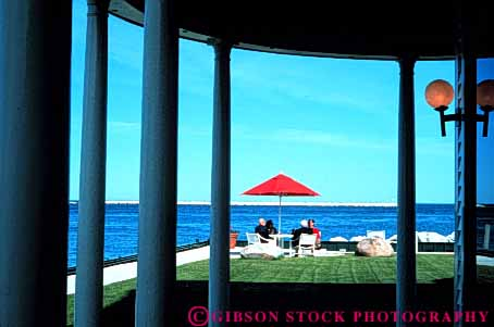 Stock Photo #3567: keywords -  calm carriage cocktail couple horz house island mackinac michigan outdoor patio private relax social solitude talk travel umbrella waiter