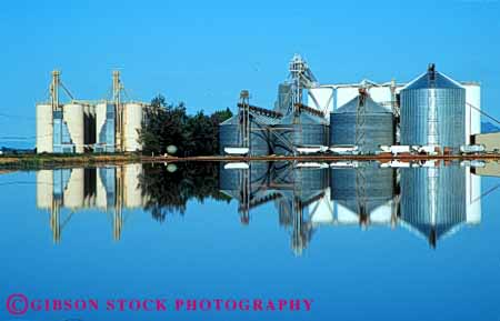 Stock Photo #6028: keywords -  agriculture blue buildings clean clear crop crops farm grow horz marysville plant pond reflect rice silo silos symmetry water