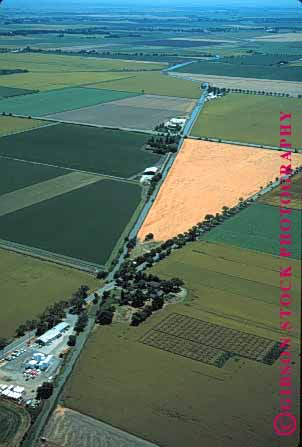 Stock Photo #1296: keywords -  aerial aerials agriculture california crop crossroads elevated farm farmland field fields food geometric grid grow horizon land line linear patchwork produce sacramento sky valley vert