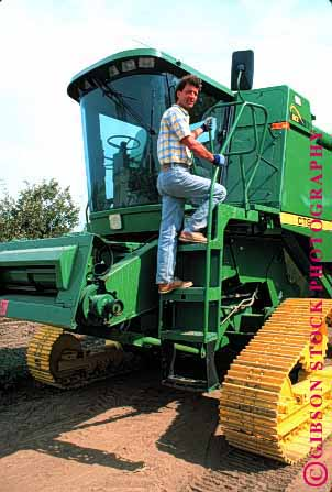Stock Photo #1300: keywords -  big california climb climbing climbs equipment farmer farmers farming harvester heavy in large man men onto people person released tractor tractors up upward vert