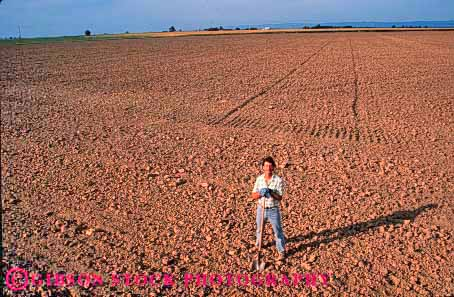 Stock Photo #1306: keywords -  agriculture bare barren big california dirt disked earth employee empty farm farmer farmers farmland field horz in industry job large occupation plowed released soil standing turned unplanted worker