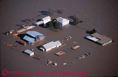 Stock Photo #1322: keywords -  aerial aerials agriculture barn building buildings california claim damage damaged danger disaster disasters farm farmland farms flood flooded flooding floods high home horz house insurance loss mud natural of overflow property rain risk river sacramento valley water weather
