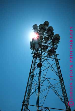 Stock Photo #1345: keywords -  communicate communications industry microwave radio silouette sun technology telecommunicat tower vert