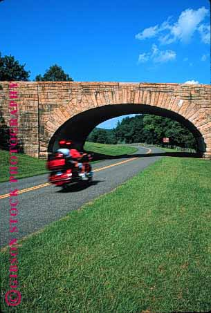 Stock Photo #1353: keywords -  blue blur bridge carefree country couple cruise drive driver glide helmet motion motorcycle moving parkway passenger ride ridge rural share steer stone together tour vehicle vert virginia