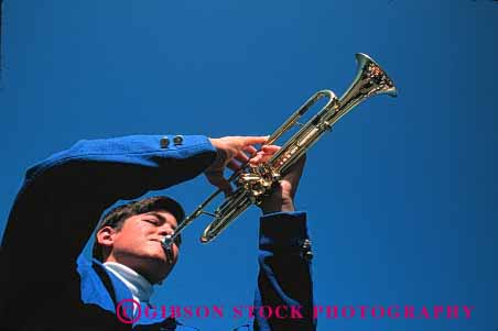 Stock Photo #1360: keywords -  adolescent art blue boy brass coordination finger high horz instrument juvenile learn listen male man music musician practice school skill sound student teach trumpet wind young