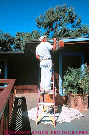 African American man painting house Stock Photo 15852