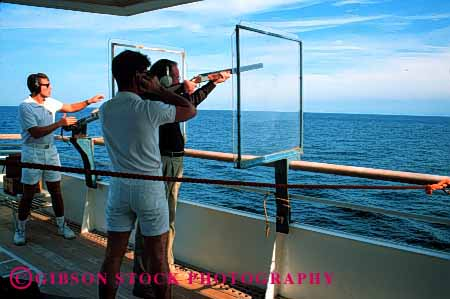 stock photo 1395 keywords adventure boat cruise fun gun horz men noise ocean - Cruise Ship Photographer
