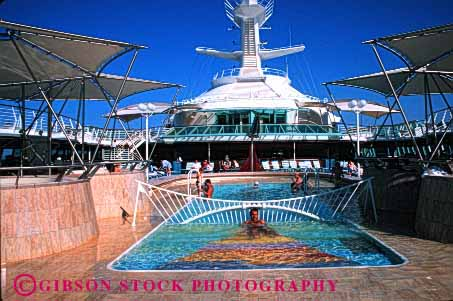 Stock Photo #1417: keywords -  adventure boat cruise elegant fun horz liner ocean of opulent passenger pool recreation relax rhapsody sea seas ship summer sunshine swim travel trip vacation warm