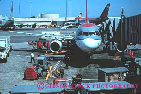 Stock Photo #1432: keywords -  airliner airplane airport change clean fly francisco fuel horz inspect jet luggage maintenance men passenger reload renew san service supply team travel work