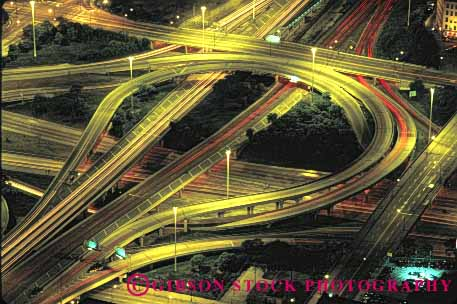 Stock Photo #1477: keywords -  aerial auto car chicago city cloverleaf commute drive dusk elevate freeway highway horz illinois interchange intersection interstate lighting move night pavement road street suburb traffic transportation truck vehicle