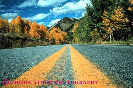 Stock Photo #1507: keywords -  aspen autumn closeup colorado country countryside fall foliage horz landscape mountain remote road route rural scenic street stripe yellow