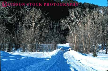 Stock Photo #1532: keywords -  cold country countryside danger horz idaho landscape mountain remote risk road route rural slippery snow storm street sun tree valley winter