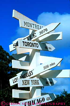 Stock Photo #6191: keywords -  aim array arrow cities city citys cluster direct direction directions locate location many name names navigate navigation point post sign signs vert white