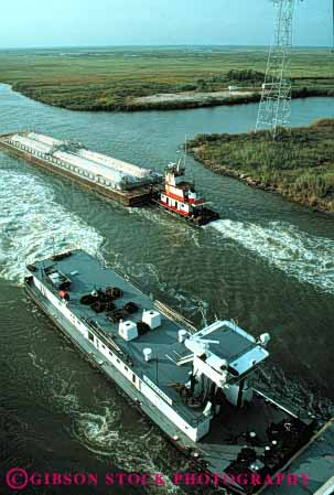 Stock Photo #6186: keywords -  barge barges boat canal commerce industry intercoastal push river ship shipping texas transport transportation transporting tugboat vert water waterway work