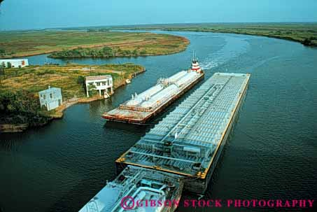 Stock Photo #6187: keywords -  barge barges boat canal commerce horz industry intercoastal push river ship shipping texas transport transportation transporting tugboat water waterway work