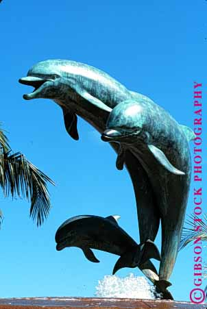 Stock Photo #1586: keywords -  animal jump leap mammal metal porpoise sculpture sky statue vert weathered