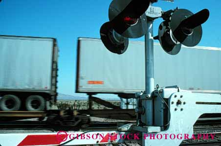 Stock Photo #1613: keywords -  bright colorful crossing danger freight gate horz industry light passing railroad stop train transportation warning