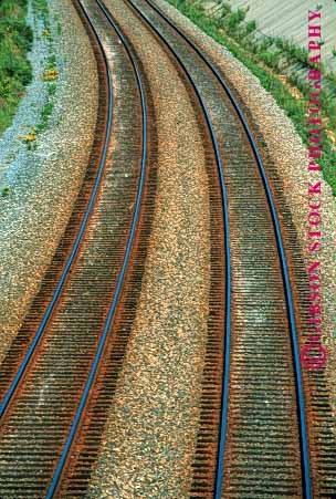 Stock Photo #1619: keywords -  elevated geometric geometry industry lines parallel railroad shipping steel tracks train transportation vert view