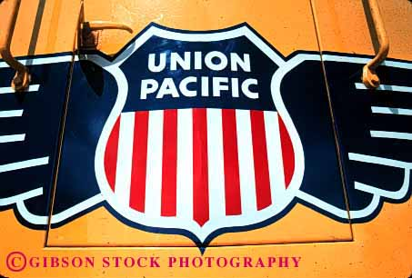 Stock Photo #1621: keywords -  americana blue engine equipment horz industry locomotive logo machine pacific railroad red shield shipping train transportation union white wing yellow