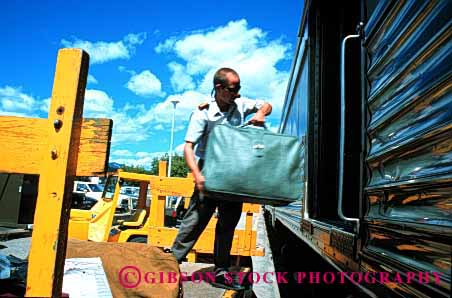 Stock Photo #1625: keywords -  baggage banff handler horz industry job load passenger railroad service shipping station train transportation work