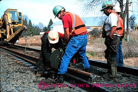 Stock Photo #1629: keywords -  cooperate cut ethnic hardhat heavy hispanic horz industry maintenance men power rail railroad repair saw team track train transportation work